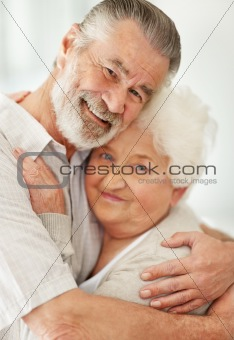 A loving mature couple embracing each other