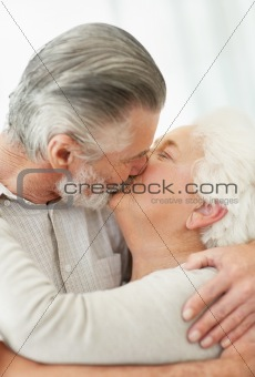 Portrait of a romantic mature couple kissing each other