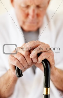 Closeup of a senior man holding a walking stick