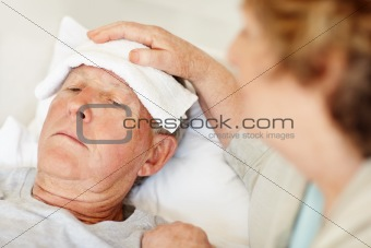 Closeup of caring senior female with a sick elderly man