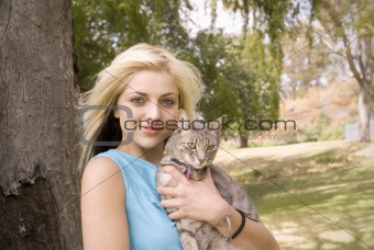 Portarit of woman or girl with cat