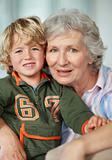 Loving grandmother with her grandson smiling together