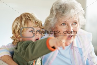 Boy showing something interesting to his grandmother