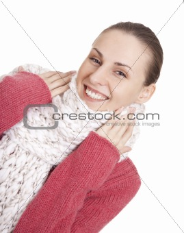 Beautiful woman in winter sweater and scarf