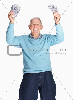 Cheerful man holding dollars up in air isolated against white