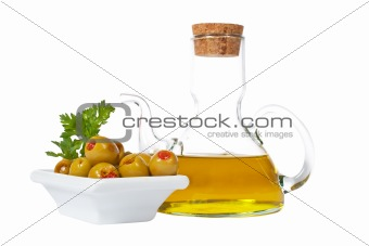 Oilcan and olives with parsley