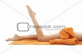 long legs of relaxed lady with orange towel #2