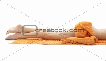 long legs of relaxed lady with orange towel #3