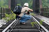 people taking photo along the deserted railway track