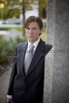 businessman behind corner