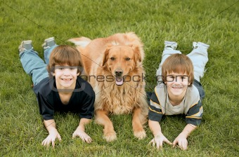 Boys Laying with the Dog