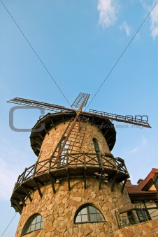 stylized windmill at blue sky
