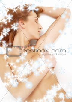 sleeping redhead with colorful collar ans snowflakes