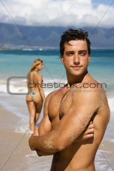Man posing on beach.