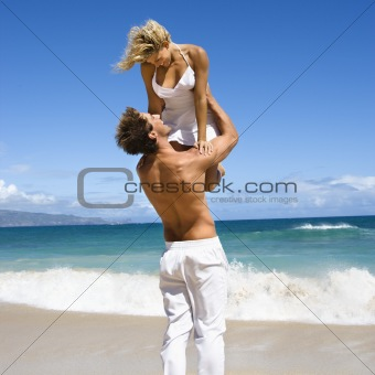 Man holding woman.