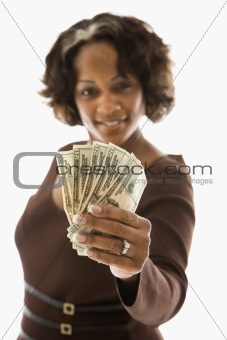 Woman holding money.