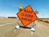 Road closed ahead sign.