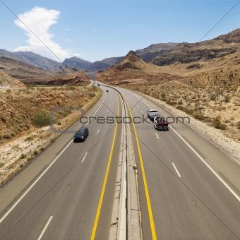 Cars on desert highway.