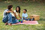 Family picnic in park.