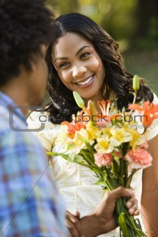Woman getting flowers.