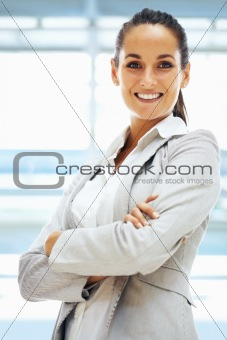 Confident woman standing with arms folded