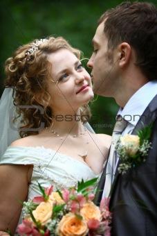 Bride looking in groom's eyes