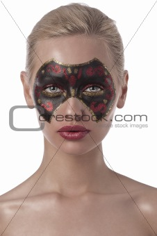 carnival mask painted on face