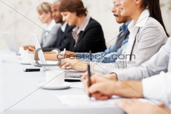 Executives writing notes