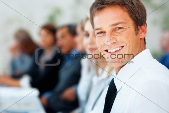 Executive smiling during meeting