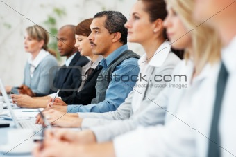Executives listening during meeting