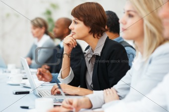Female executive listening during meeting