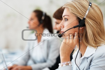 Cute customer service executive with colleagues