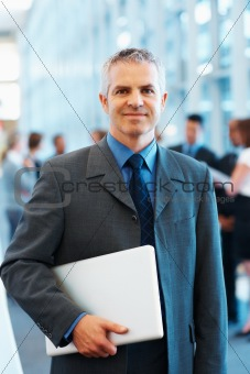 Senior executive holding a laptop