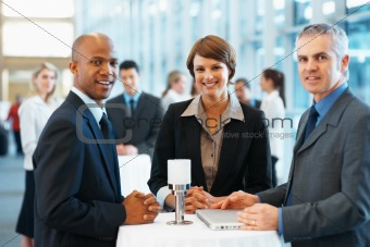Business colleagues smiling at a conference hall