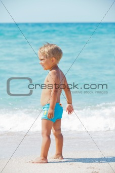 little boy and blue sea