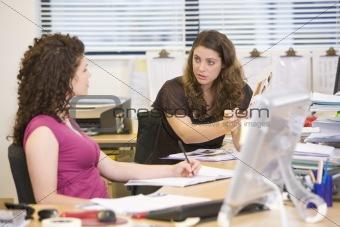 Women having an argument at work