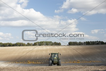Tractor Spraying Field