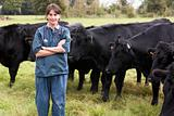 Portrait Of Vet In Field With Cattle