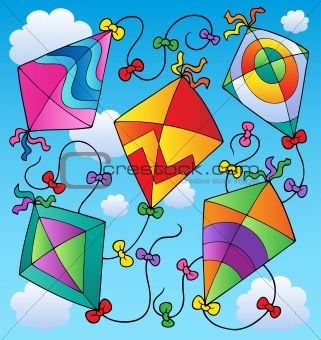 Various flying kites on blue sky