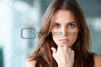 Portrait of thoughtful young lady looking at you - Copyspace