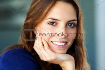 Closeup portrait of happy young lady smiling