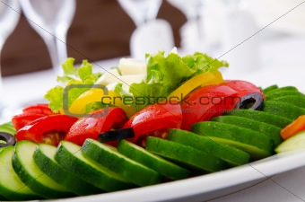 Cucumber and tomato salad in plate