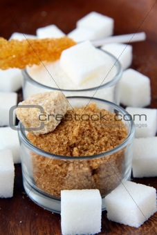 Several types of sugar - refined sugar, brown sugar and granulated sugar