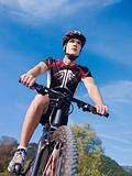 young man training on mountain bike