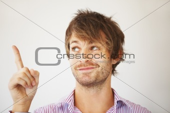 Attractive man pointing up
