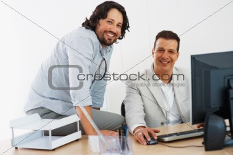 Happy business men at work