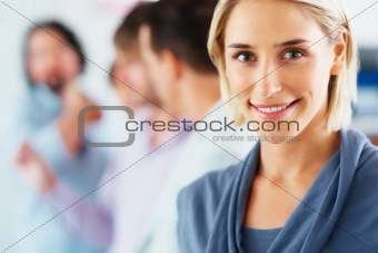 Happy woman with group in background