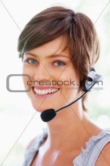 Young call center executive smiling