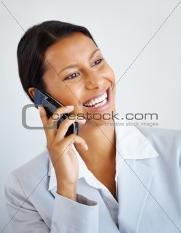 Happy female executive on phone call