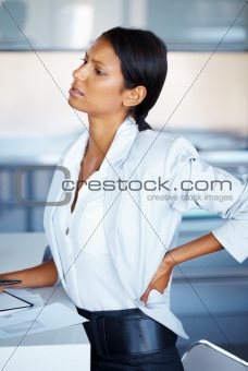 Female executive stretching